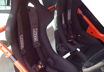 Auto style bucket seats fitted with LUKE harness belts