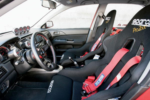 Sparco pro 2000 seats fitted with Sparco harness belts
